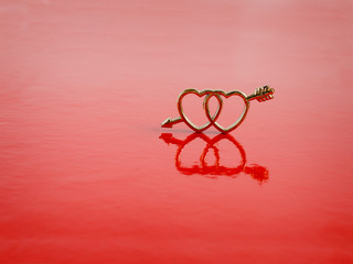 two hearts are on  red background