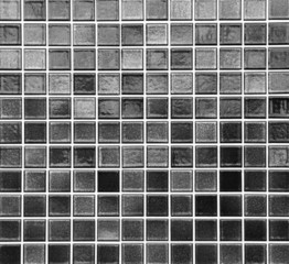 Black mosaic tile wall seamless background and texture