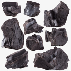 Coal lumps spilled on white