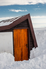 Wooden hut in the snow