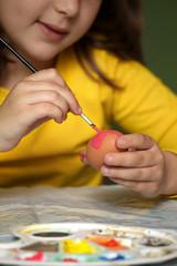 Girl painted Easter eggs