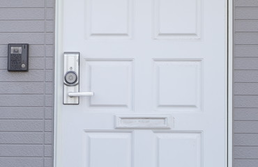 White wood door and brick wall background