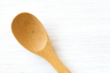 Wood brown spoon on white wood table background