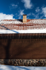 Wall of the house and icicles from the roof