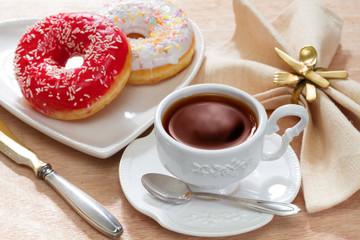 Hot tea with delicious doughnut
