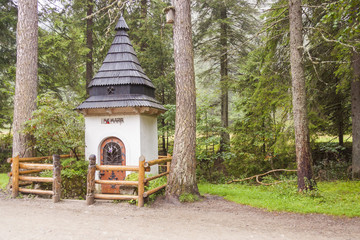 Small white shrine on trail in Koscieliska valley.