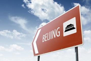 Beijing direction. Brown road sign.