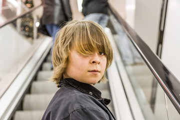 portrait of child on moving staircase