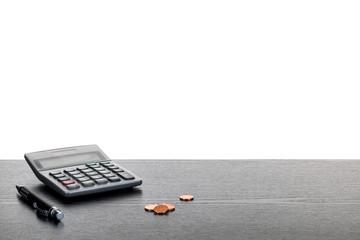 Taschenrechner Stift und Münzen