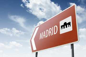 Madrid direction. Brown road sign.