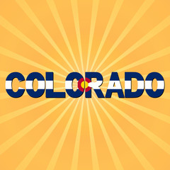 Colorado flag text with sunburst illustration