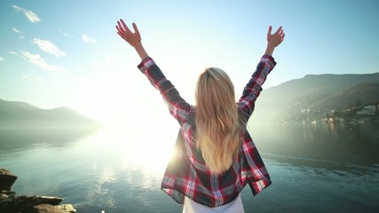 Happy woman arms outstretched for freedom