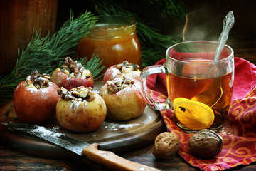 Apples baked with nuts and honey and tea with a lemon