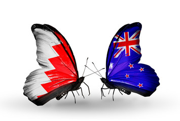Two butterflies with flags Bahrain and New Zealand