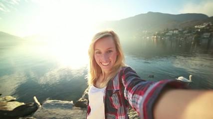 Young woma taking selfie-Mountain/Lake