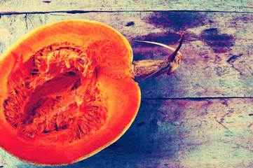 Pumpkin on a vintage wooden background