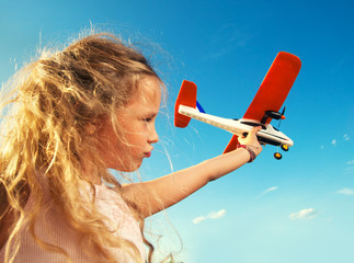 Girl playing with plane