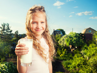 Girl holding glass with milk