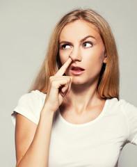 Woman picks his nose finger