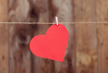 Heart made of paper hanging on a rope