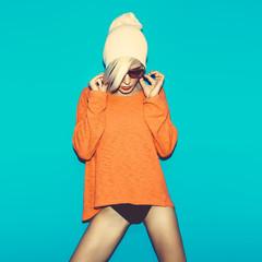 Glamorous blonde on bright blue background. fashion party style