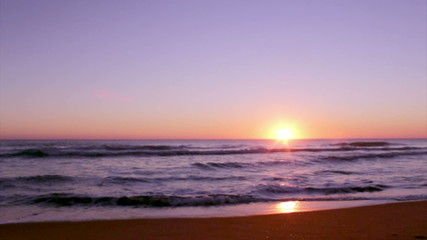 Sunset at Dunas Douradas beach, Algarve.