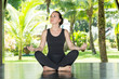 Young woman is practicing yoga and pilates on nature