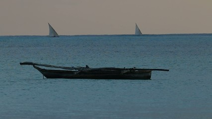 Wooden boats (dhows) at sunrise, Zanzibar island