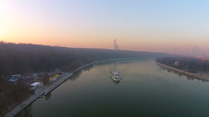 Flying over the river boat at sunset, flying over the river
