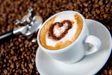 cappuccino on a lot of coffee beans - 76216855