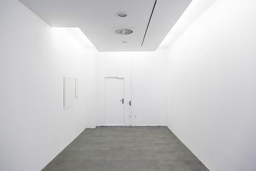 Long walkway and white wall