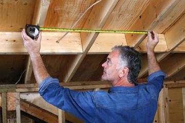 Mature man doing home renovations.