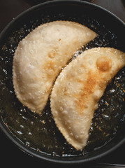 meat pasty fried in boiling sunflower oil