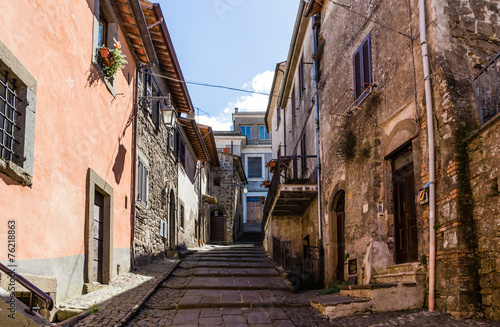 street in medieval town, Italy - 76218863