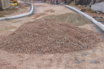 Pile of crushed gravel on road construction site