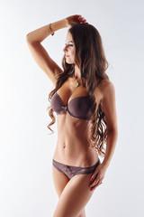 Statuesque woman advertises erotic lingerie