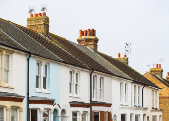 Mainly white terrace houses in a row