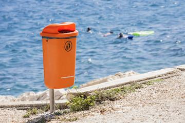 Trash bin near the sea. Littering the beach.