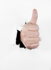 Hand with thumb up in approval gesture