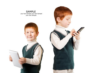 Cute red haired child poses with tablet pc and smartphone. Isola