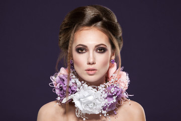 portrait of girl with violet make-up and flowers