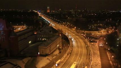 Traffic on a platform at night, Warsaw
