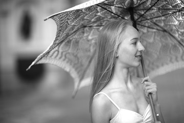 Beautiful  woman portrait with a knitted umbrella