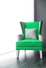 Modern green fabric armchair