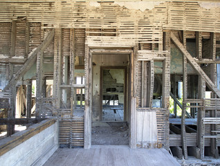Damaged rooms of Old Abandoned Wooden House