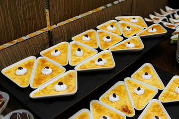 Catering - served table with crème brulee desserts