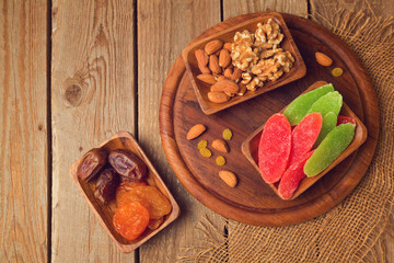 Dry fruits and nuts on wooden table. View from above