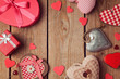 canvas print picture - Valentine's day background with heart shapes on wooden table