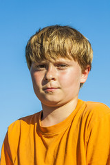 sweating boy after sports under blue sky