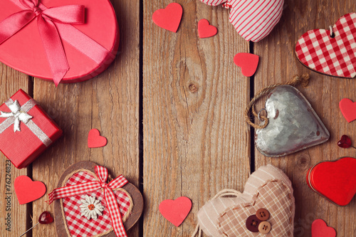 canvas print picture Valentine's day background with heart shapes on wooden table